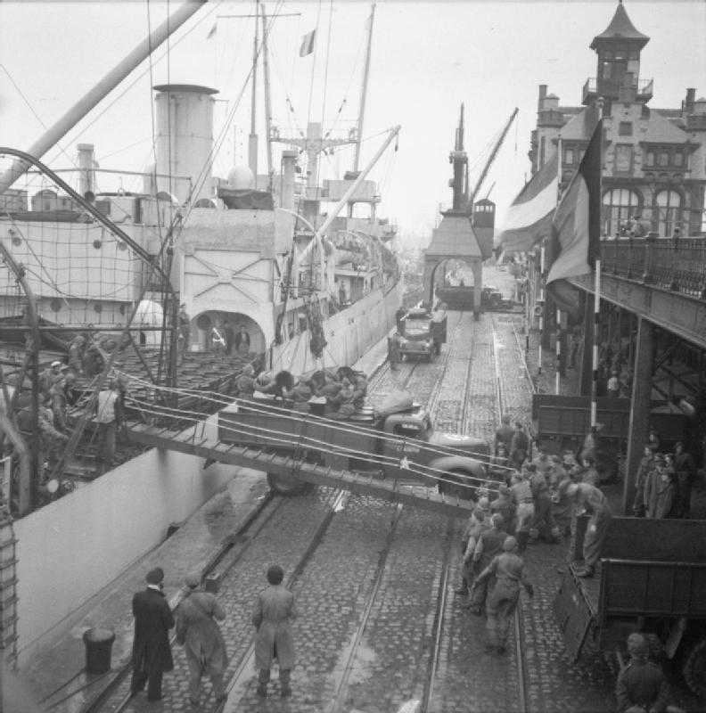 Oil being unloaded from the SS &_39;Fort Cataraqui&_39; in the port of Antwerp, 30 November 1944.