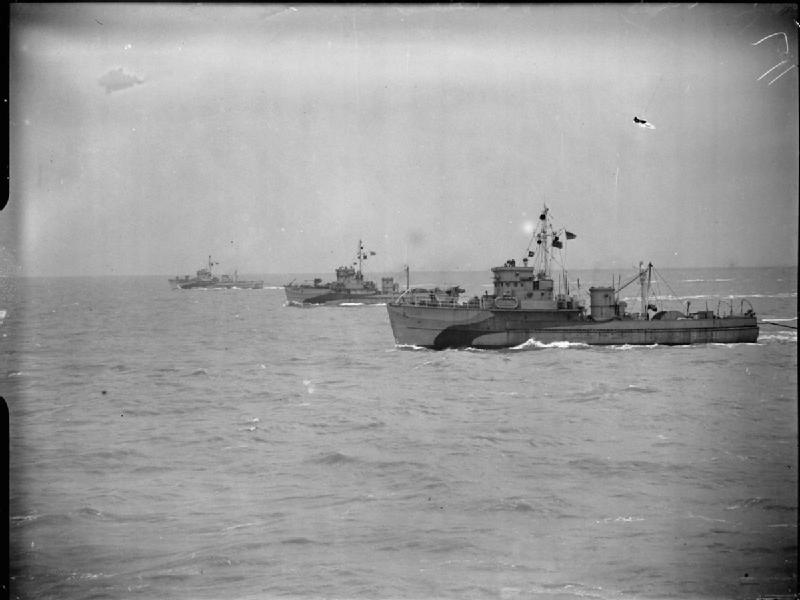 Three British Yard Minesweepers (including BYMS 2058) sweeping abreast in the Scheldt estuary